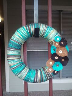 Blue & Browns Yarn Wrapped Wreath with Felt Flowers by GrayBare, $37.00