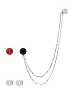 'Punk Kiss' set of earring and ear cuff: a pair of asymmetric earrings featuring a chained ear cuff and a stud earring with Swarovski encased stones in black and red. Butterfly closure.