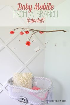 DIY Baby Mobile From a Branch   via Make It and Love It - want to use for picture display instead for M's room