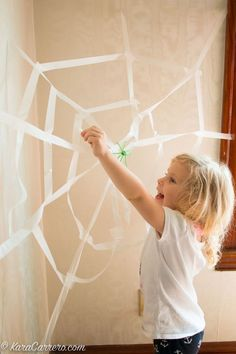 Spider learning activities, recommended books, free resources, and how to make a model spider web for learning games.