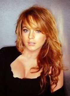 Subtle blonde highlights on red hair.