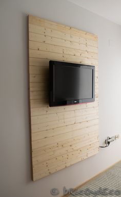 DIY Laminate Flooring on Walls and 30 Inspirations Cacher Cable Tv, Panneau Mural Tv, Tv Wall Design, House Design, Hide Tv Cords, Hide Tv Cables, Hide Cable Box, Laminate Flooring On Walls, Tv Wall Panel