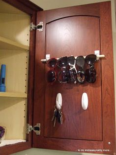 Command Hooks for keys and sunglasses inside a cabinet door