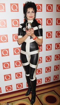 @jedi_jeff       'I'm not dead!' Siouxsie Sioux shows off her trim figure in a rubber jumpsuit at the Q Awards in London yesterday
