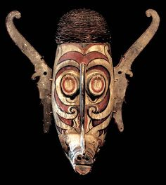 DAYAK TRIBE: BAHAU HAND CARVED CEREMONIAL MASK WOOD, FIBER, POLY CHROME WATER BASED PIGMENTS