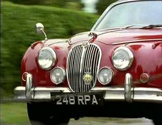 """1960 Jaguar Mk. II in Regency Red, owned by the BBC, used in """"Inspector Morse"""". Restoration cost was £100,000 in 2005"""