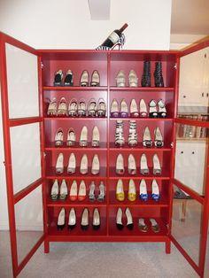 Red shoe storage. Ikea bookshelf, red Linnarp with glass doors.