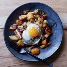 Start your day off right with this roasted vegetable and fried egg dish by chef Susan Feniger.Get the recipe on Food & Wine.