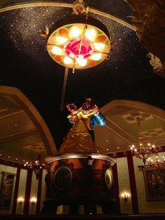 Be Our Guest Restaurant with the music box and the stained glass rose