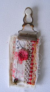 buckle as art holder-- I have a few garter clips . . . thinking about Mother's Day gifts
