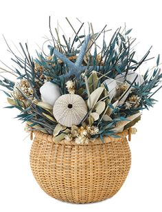 St. Thomas centerpiece: seashells and dried sea grass with starfish in basket