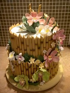 Pineapple Bakery - Hawaii Cake Bakers - Tropical-themed wedding cake with fondant flowers and bamboo