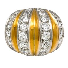 VAN CLEEF & ARPELS Gold and Diamond Bombe Ring. A Retro vertically striped, gold and diamond ring of bombe design, in 18k and platinum. Approximate total weight: 4.02 carats. Van Cleef & Arpels, France.