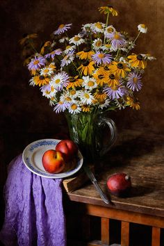 http://nikolay-panov.artistwebsites.com/products/colorful-daisies-nikolay-panov-art-print.html • Still life with bouquet of colorful Daisies, fresh peaches and silky-smooth drapery on vantage wooden table in summerhouse in midsummer.