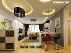 Modern false ceiling designs for living room interior    cover up the ceiling but add circle lighting around the piping