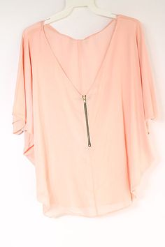 Light, breezy and effortless pullover tunic with a zipper