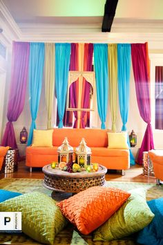 an array of seating spaces..vibrant, eclectic, colorful decor