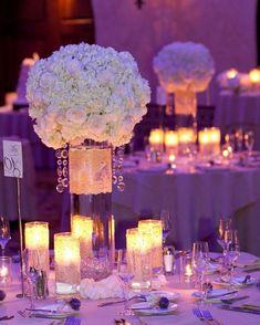 Unique #centerpieces glow nicely under #uplight lighting! Great photo via #designedbyajafloral
