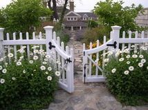 Set the fence back. Placing a low fence or wall back a few feet from the edge of the sidewalk allows room for planting, and plants provide v...