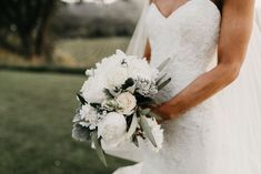 Delicate ivory and white english rose and peony bridal bouquet with hints of greenery and dusty miller. Floral by Willow Flower Designs. Photo by Erin Northcutt and Feather + North, Wedding Planning by Bella Baxter Events.