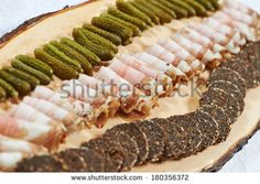 catering services. Plate with bacon cornichon snacks and food in restaurant - stock photo