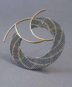 Brooch | Hanne Behrens. Braided, silver 750 and 585 gold. Hanne Behrens is a Danish artist who is known for her exquisite craftsmanship and the pure, clean lines of her designs