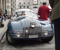 Fiat 1100 Ala d'Oro    Visual splendor wow— outrageous chrome, cool split windshield... an Art Director's car :)