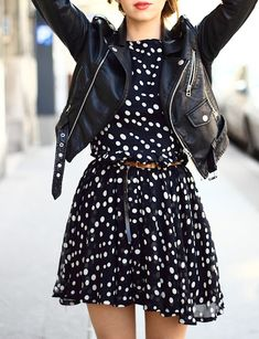 A simple polka dot dress and edgy leather jacket.