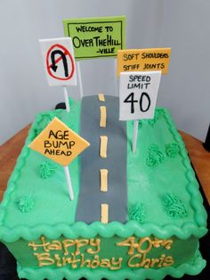- Over the hill 40th birthday cake with custom gum paste signs, road, grass