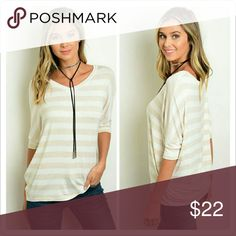 """Ivory Tank Striped Top Short sleeve striped dolman sleeve top.  Fabric Content   95% Rayon 5% Spandex   Size Small Measurements   L: 26"""" B: 38"""" W: 48"""" Tops Tees - Long Sleeve"""