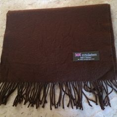 100% Cashmere Scarf. - Brown 100% Cashmere Scarf. - Brown. Made in Scotland. Hand wash cold or dry clean. Excellent condition. Size is 12 inches wide X 67 inches long and 3 1/2 inch fringe on each end. Accessories Scarves & Wraps