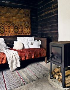Cozy. Finnish magazine Avotakka...the rugs and the white linens with the dark and the beautiful warm rust coverlet
