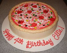 "Pizza birthday cake - This cake was for a little girl who had a ""Make Your Own Pizza"" birthday party.  This was fun to make!  I used fruit roll-ups for the pepperoni and green peppers, and there are M&M's and Skittles on there, too.  :)"
