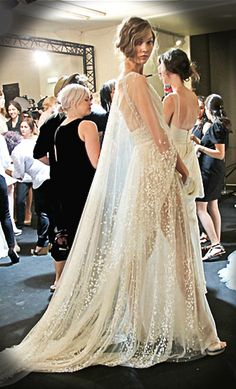 Elie Saab. This is amazing over a lingerie like wedding dress. I love this idea for the ceremony w/ hair either pulled to side in unkept beautiful lonnng braid and head dress, or flowers in. Or hair down and long w/ volume and soft curls and gems going down strands and headdress cascading down back of hair