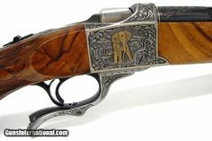 Ruger No. 1 375 H&H Mag caliber rifle. Outstanding Angelo Bee engraved Safari rifle made on a Ruger No. 1 receiver with deep relief engraving and gold inlaid African game scenes.