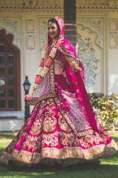 Bright Magenta and Gold Sabyasachi Lehenga Beautifully Worn by Mugdha Agarwal