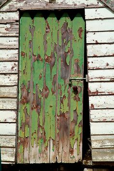 Out House, Dunny Door by Joe Mortelliti  An old outdoor dunny on a farm property with lots of character in the green peeling paint and timber structure.