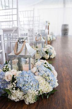rustic wedding lanterns metal lights with blue flowers adorn the passage flowersbyjanie via instagram
