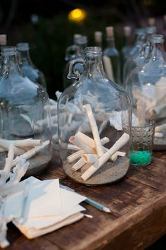 LOVE THIS IDEA.  Message in a bottle guest book (people can write messages of their well wishes, or a piece of advice, or answer a question you ask them. For example, 'what is your favorite memory of the bride and groom' or 'what should we name our first child', etc.)
