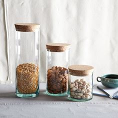 These West Elm jars are super cute. I wonder if I could find similar vases/glasses at Goodwill and buy cork stoppers for them?