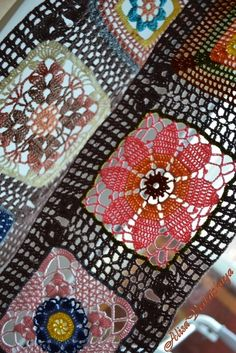 colorful lace crochet square motifs...site needs translation...this is a beautiful curtain and the free diagrams are on site at bottom...BEAUTIFUL CROCHET !!!