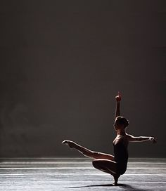 I soooo want to photograph a dancer with dramatic lighting like this! I love the graceful lines their bodies make.