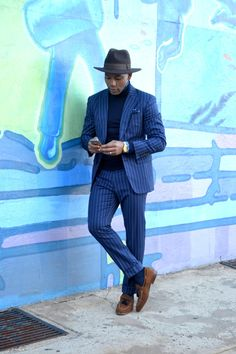 Rock a chalk stripe suit over a tailored button-down with a cutaway collar and a tailored turtleneck sweater. Top it all with a flat-brimmed fedora and you'll look like you do business in Italy on the regular.