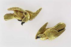 Pair of menuki in the form of hawks  Japanese, mid-19th century Main material: gold; other metals: shakudo and shibuichi; decorative technique: uchidashi, takabori, zogan