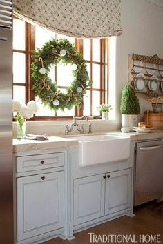 Love the cabinet color and farmhouse sink! Decorating: Holiday Wreaths - Traditional Home®