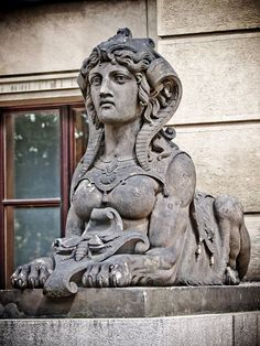 One of the two sphinx statues guarding the entrance to the Rudolfinum Music Hall in Prague.
