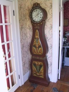 *I adore this clock!* An antique Mora clock painted in dark reddish brown and a lovely Kurbits design.