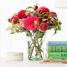Rethink Pink     How do you create a gorgeous centerpiece? Keep it simple—dahlias and hellebores clustered in a glass vase speak for themselves. Note: When you use clear containers the stems become part of the bouquet, so trim neatly and arrange with care.