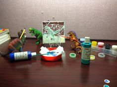 """Painting dinos in the library. #LPLSDinovember is underway! Send us a picture of what dinosaurs do at your house overnight. The best entry will win a prize! You could win the movie """"Jurassic World"""" on DVD or """"Jurassic World: Where Dinosaurs Come to Life"""" book! Email your pictures to contest@lpls.info, post your photo to Lorain Public Library System's Facebook page, or tweet your picture at the library (@LorainLibrary). Include #LPLSDinovember. Good luck! #Dinovember2015"""