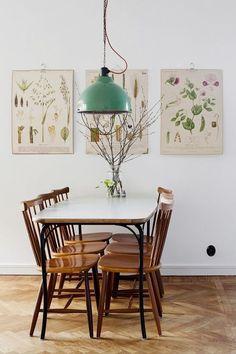 decoração de sala de jantar com posters tama botânica